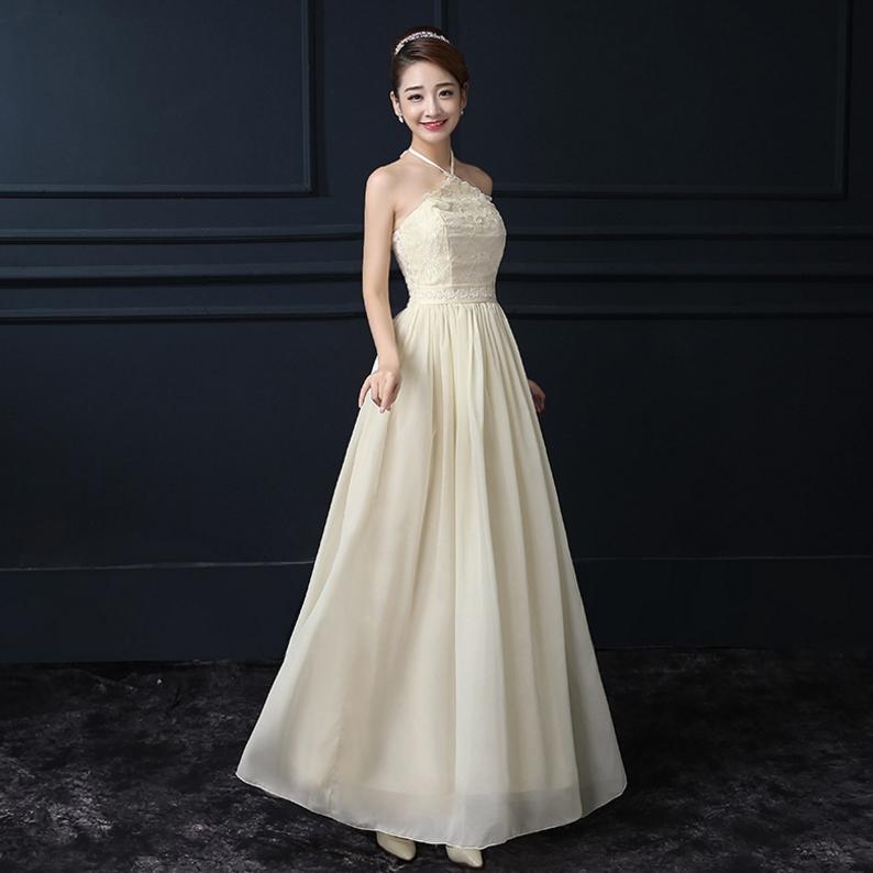 ชุดราตรียาวสีครีม ผูกคอ ลุคสวยสง่า ดูดี เหมาะสำหรับชุดใส่ออกงาน ไปงานแต่งงานแต่งงาน ธีมงานสีครีมเบจ ราคาถูก