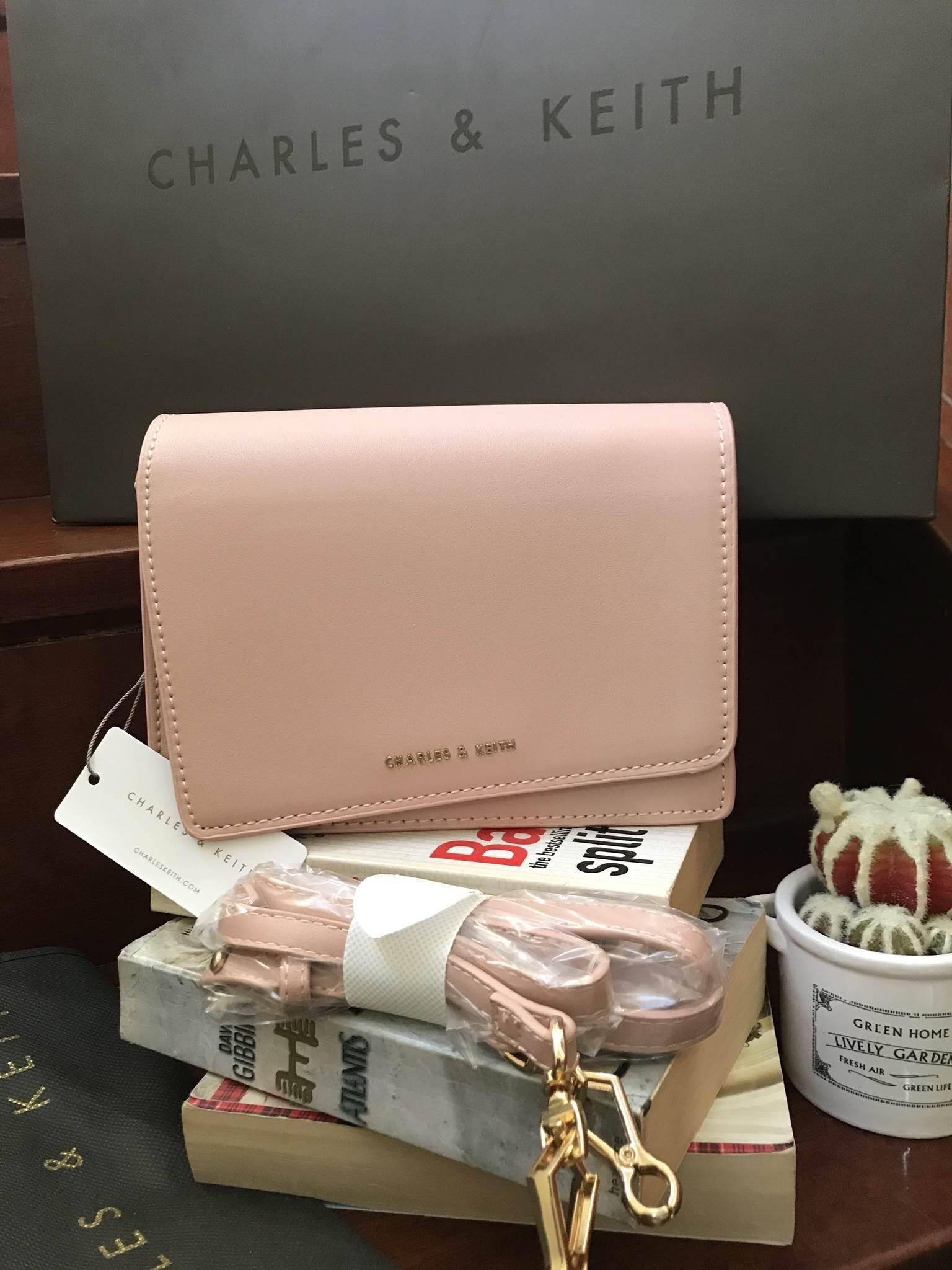 CHARLES & KEITH ASYMMETRIC FRONT FLAP BAG *สีชมพู