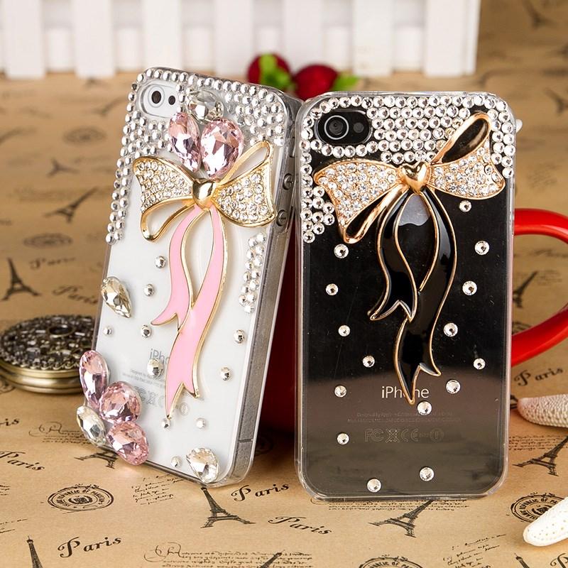 เคสไอโฟน 4/4s (Case iphone 4/4s) เคสไอโฟนกรอบโปร่งใส ประดับเพชรและโบว์สีดำ (ภาพด้านขวา)