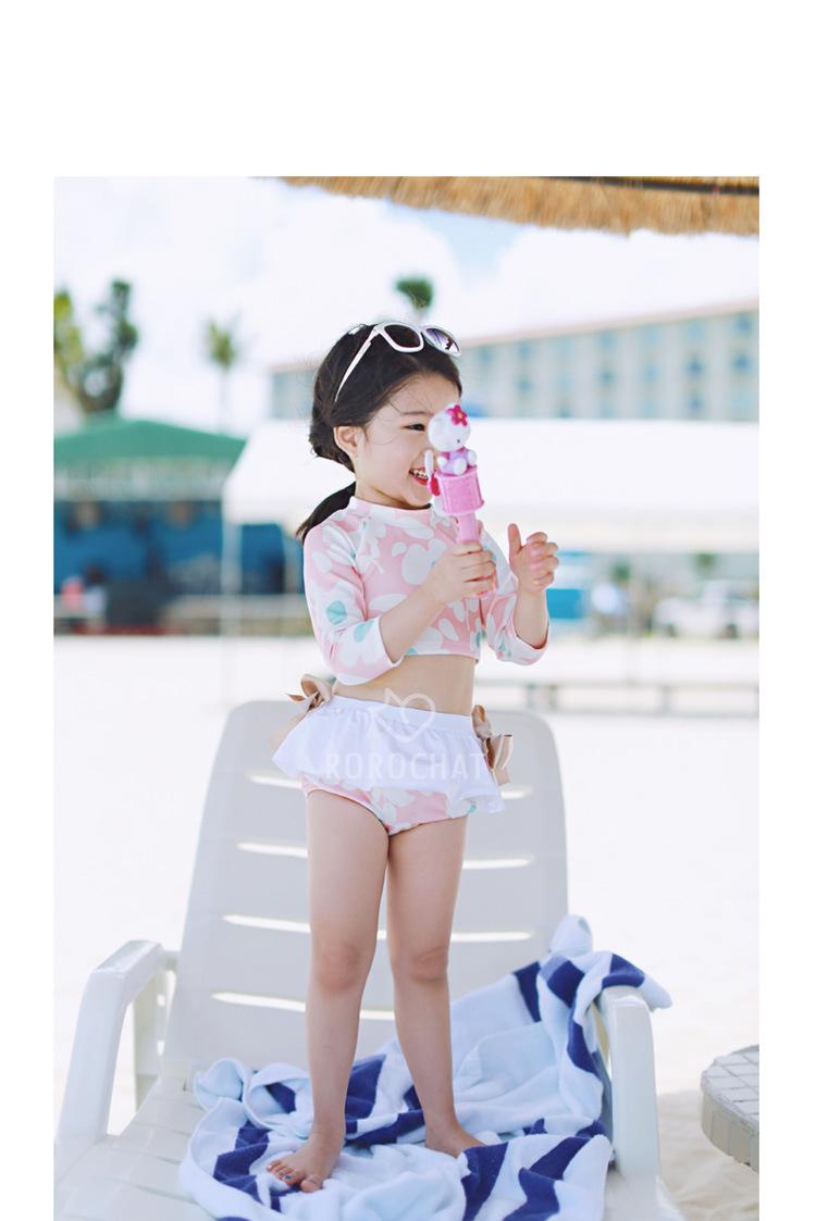 ชุดว่ายน้ำเด็กทูพีชลายดอกไม้สีชพมู