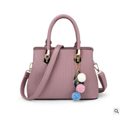 พร้อมส่ง ขายส่งกระเป๋าถือและสะพายข้างใบเล็ก เย็บลายทาง แฟชั่นผู้หญิง รหัส Sunny-978 สีชมพูอ่อน 1 ใบ *แถมพู่ห้อ